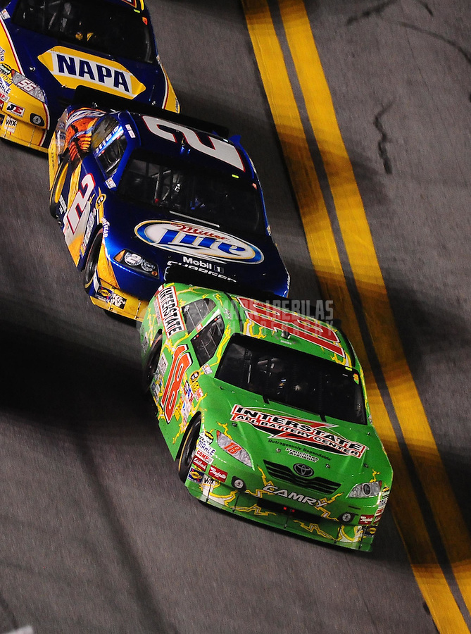 Jul. 3, 2010; Daytona Beach, FL, USA; NASCAR Sprint Cup Series driver Kyle Busch (18) leads brother Kurt Busch (2) during the Coke Zero 400 at Daytona International Speedway. Mandatory Credit: Mark J. Rebilas-