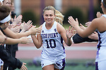 Hayley Norris (10) of the High Point Panthers high fives her teammates during player introductions prior to the match against the North Carolina Tar Heels at Vert Track, Soccer & Lacrosse Stadium on February 16, 2018 in High Point, North Carolina.  The Tar Heels defeated the Panthers 14-10.  (Brian Westerholt/Sports On Film)
