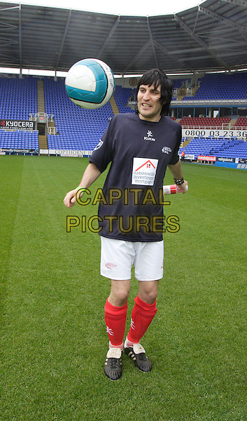 NOEL FIELDING.Soccer Six tournament in aid of the Samaritans at Reading FC's Madejski Stadium, Reading, England, UK, .May 26th 2008.Full length playing football match pitch raining ball kicking red socks kit white shorts wet hair.CAP/ROS.©Steve Ross/Capital Pictures