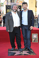 Director Peter Jackson with actor Andy Serkis (left) on Hollywood Blvd where he was honored with the 2,538th star on the Hollywood Walk of Fame.<br /> December 8, 2014  Los Angeles, CA<br /> Picture: Paul Smith / Featureflash