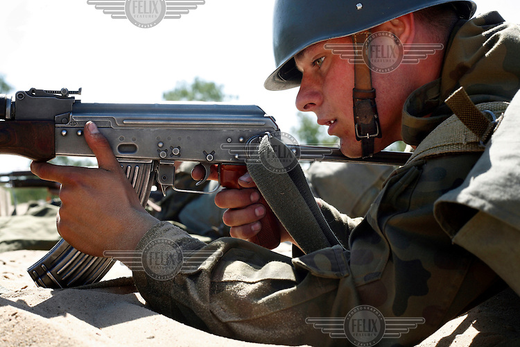 Private Bartek Frajer learning to shoot his AK-47 Kalashnikov rifle. This year's class of drafted recruits is the final one after 90 years of compulsory military service, as Poland's army turns professional in 2009.
