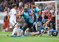 Adebayo Akinfenwa of Wycombe Wanderers tries to ride the tackles during the Friendly match between Aldershot Town and Wycombe Wanderers at the EBB Stadium, Aldershot, England on 26 July 2016. Photo by Alan  Stanford.