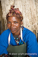Africa, Swaziland, Malkerns. Nest organization artisan project, partnering with Coral Stephens handweaving workshop. Women carding wool. Margareth.