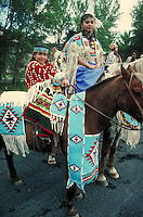 Portrait of Indian ceremonial dress on people and horses. Indian woman and child. Warm Springs Oregon USA.