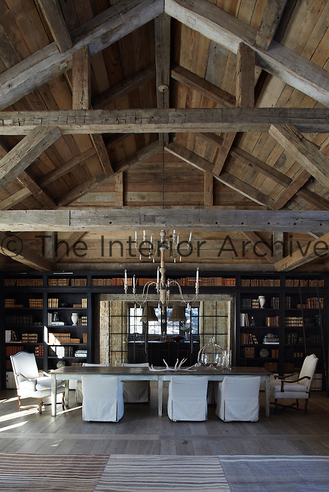 A real barn has been used to create a 1000 square-foot great room, sided in reclaimed wood, which stands at the centre of the compound