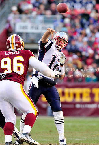 New England Patriots quarterback Tom Brady (12) passes over Washington Redskins nose tackle Barry Cofield (96) in fourth quarter action at FedEx Field in Landover, Maryland on Sunday December 11, 2011.  The Patriots won the game 34 - 27..Credit: Ron Sachs / CNP.(RESTRICTION: NO New York or New Jersey Newspapers or newspapers within a 75 mile radius of New York City)