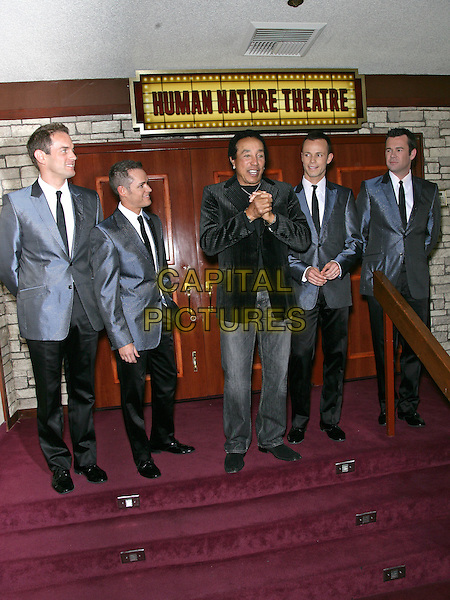 SOMKEY ROBINSON.Smokey Robinson Joins Human Nature to celebrate their 1 year anniversary at the Imperial Palace Hotel and Casino, Las Vegas, Nevada, USA, .11th  May 2010..full length black velvet jacket blazer jeans pinstripe striped  cast hands .CAP/ADM/MJT.© MJT/AdMedia/Capital Pictures.
