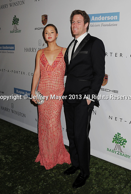 CULVER CITY, CA- NOVEMBER 09: Actress/model Devon Aoki (L) and James Bailey arrive at the 2nd Annual Baby2Baby Gala at The Book Bindery on November 9, 2013 in Culver City, California.