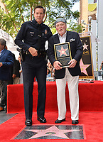 LOS ANGELES, CA. July 31, 2019: Stacy Keach & LAPD Captain Cory Palka at the Hollywood Walk of Fame Star Ceremony honoring Stacy Keach.<br /> Pictures: Paul Smith/Featureflash