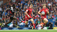 Wales's James Davies breaks forward with the ball<br /> <br /> Kenya Vs Wales - men's placing 5-8 match<br /> <br /> Photographer Chris Vaughan/CameraSport<br /> <br /> 20th Commonwealth Games - Day 4 - Sunday 27th July 2014 - Rugby Sevens - Ibrox Stadium - Glasgow - UK<br /> <br /> © CameraSport - 43 Linden Ave. Countesthorpe. Leicester. England. LE8 5PG - Tel: +44 (0) 116 277 4147 - admin@camerasport.com - www.camerasport.com