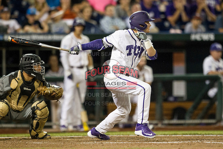 TCU Horned Frogs outfielder Evan Williams (27) follows through on his swing during the NCAA College baseball World Series against the Vanderbilt Commodores on June 16, 2015 at TD Ameritrade Park in Omaha, Nebraska. Vanderbilt defeated TCU 1-0. (Andrew Woolley/Four Seam Images)