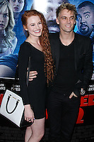 """LOS ANGELES, CA, USA - APRIL 16: Madelaine Petsch and Aaron Carter arrive at the Los Angeles Premiere Of Open Road Films' """"A Haunted House 2"""" held at Regal Cinemas L.A. Live on April 16, 2014 in Los Angeles, California, United States. (Photo by Xavier Collin/Celebrity Monitor)"""