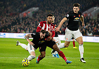 Sheffield United's Lys Mousset vies for possession with Manchester United's Phil Jones and Harry Maguire <br /> <br /> Photographer Alex Dodd/CameraSport<br /> <br /> The Premier League - Sheffield United v Manchester United - Sunday 24th November 2019 - Bramall Lane - Sheffield<br /> <br /> World Copyright © 2019 CameraSport. All rights reserved. 43 Linden Ave. Countesthorpe. Leicester. England. LE8 5PG - Tel: +44 (0) 116 277 4147 - admin@camerasport.com - www.camerasport.com