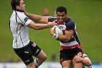 Lelia Masaga tries to fight his way out of the Israel Dagg tackle & fend off Zac Guildford. Air New Zealand Cup Rugby game between Counties Manukau & Hawkes Bay, played at Growers Stadium Pukekohe on Sunday 14th of September 2008.