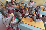Students learn about electricity in the Loreto Primary School in Rumbek, South Sudan. The Loreto Sisters began a secondary school for girls in 2008, with students from throughout the country, but soon after added a primary in response to local community demands.