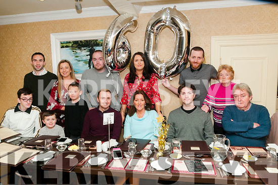 60th birthday: Kathleen McDonnell, Listowel, third from right seated, celebrating her 60th birthday with family at Behan's Horseshoe Restaurant, Listowel on Friday night last. Front: Patrick Walsh, Scott & Ryan McDonnell, Nialll Dundon, & Kathleen, Darren & Danny McDonnell. Back : Damien O'Flynn, Gillian Morris, Michael, Claire, Shaun & Lizzy McDonnell.