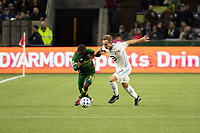 PORTLAND, OR - MARCH 01: Yimmi Chara #23 of the Portland Timbers battles for the ball with Chase Gasper #77 of Minnesota United during a game between Minnesota United FC and Portland Timbers at Providence Park on March 01, 2020 in Portland, Oregon.
