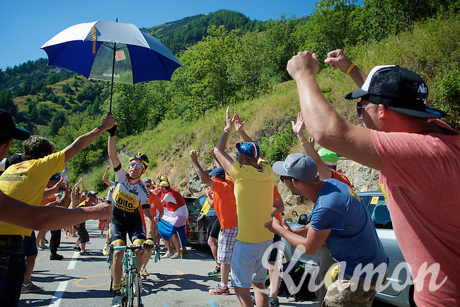 Bram Tankink (NLD/LottoNL-Jumbo) experiencing the craziness at the Dutch Corner (nr7) up Alpe d'Huez and ready to party along as he grabs a fan's old Rabobank umbrella<br /> <br /> stage 20: Modane Valfréjus - Alpe d'Huez (111km)<br /> 2015 Tour de France