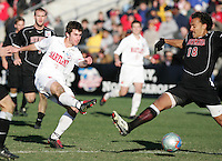 Maryland's Stephen King (7) gets a shot under the outstretched leg of New Mexico's Josh Brown (18). The University of Maryland Terrapins defeated the University of New Mexico Lobos 1-0 in the Men's College Cup Championship game at SAS Stadium in Cary, NC, Friday, December 11, 2005.