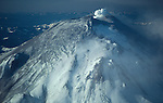 Mount St. Helens started to vent steam after it experienced a magnitude 4.2 earthquake on March 20, 1980. This was taken in April, when the north side of the mountain started to bulge. A second earthquake of magnitude 5.1 triggered the massive collapse of the north face of the mountain on May 18, 1980.
