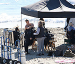 November 22nd 2010  Exclusive ..Trevor Donovan filming the television show 90210 in Malibu beach California wearing a wetsuit shirtless showing off his big sexy six pack abs & muscles while shirtless. Trevor was stretching & struggling while trying to take off his wetsuit . Trevor was surfing in a scene with Tristan Wilds as they entered a surf competition at the beach & west Beverly High battled against Zuma High..AbilityFilms@yahoo.com.805-427-3519.www.AbilityFilms.com..