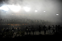 Nov. 20, 2009; Homestead, FL, USA; NASCAR Camping World Truck Series fans are shrouded by smoke following a victory burnout by Kevin Harvick following the Ford 200 at Homestead Miami Speedway. Mandatory Credit: Mark J. Rebilas-