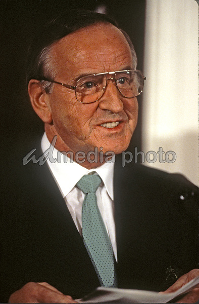 Taoiseach (Prime Minister) Albert Reynolds of Ireland makes remarks during the ceremony where he will present United States President Bill Clinton with a bowl of shamrocks honoring St. Patrick's Day with in the Roosevelt Room of the White House in Washington, DC on March 17, 1993. During his remarks, President Clinton announced he was naming Jean Kennedy Smith as US Ambassador to Ireland.<br /> Credit: Martin H. Simon / Pool via CNP/AdMedia