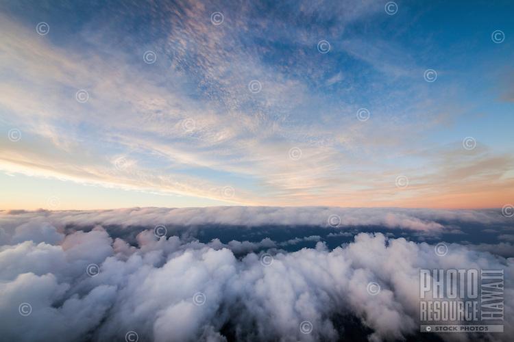 At sunset, clouds roll over Honolulu, O'ahu.