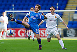 St Johnstone v Motherwell...11.09.10  .Alan Maybury clears from Robert McHugh.Picture by Graeme Hart..Copyright Perthshire Picture Agency.Tel: 01738 623350  Mobile: 07990 594431
