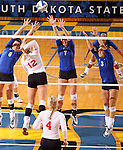 BROOKINGS, SD - OCTOBER 5:  Courtney Roberts #6, Tiara Gibson #7 and Kacey Hermann #3 from South Dakota State University team up for a block on Kendall Krittenbrink #12 from the University of South Dakota in the second game of their match Saturday night at Frost Arena. (Photo by Dave Eggen/Inertia)