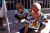 September 4, 2010. Raleigh, North Carolina..Two super heroes were spotted on Fayetteville Street challenging all villains.  In front is Amier Hockaday as Spiderman and behind him is his brother, Dexter Henton, as Batman.