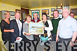 Gary McMahon signing weekend held in the Rambling Inn Abbeyfeale Friday night, this was a presentation to Joan McMahon (3rd from left), the wife of the late Gary McMahon. Pictured L-R : Trassa McMahon Mccaulife, Tommy Kenny (Chairperson), Joan McMahon, Owen McMahon, Chris O'Shea (Secretary), Rossell McMahon, Philip Enright.