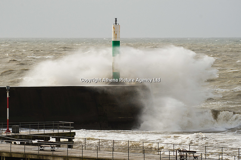 Aberystwyth Wales UK, Wednesday 02 march 2016 <br /> UK weather: At the peak of the tide, huge waves crash over the harbour wall and lighthouse as gale force winds again hit Aberystwyth in West Wales . <br /> Gusts of up to 70mph are predicted  to affect western coastal areas, , making for difficult driving conditions and bringing the risk of some structural damage .<br /> The latest storm of the winter has been officially named as Storm Jake by the Irish weather service, Met Eireann,