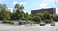NWA Democrat-Gazette/ANDY SHUPE<br /> Construction equipment from improvements at the Walton Arts Center fills a 54-space parking lot Friday, Sept. 25, 2015, east of the Nadine Baum Studios in Fayetteville. Fayetteville City Council members will consider a resolution Oct. 6 expressing their intent to lease or sell the 0.8-acre property to TheatreSquared for a new performance center.