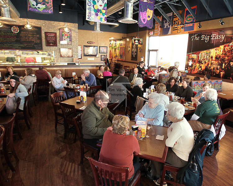 The Gulf Shores Restaurant & Grill in Edwardsville is the second location of the popular Cajun-themed eatery which has another site in St. Louis. This location is within the Edwardsville Crossing shopping complex. Busy lunchtime.