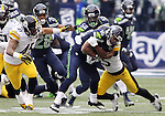 Seattle Seahawks punt return specialists Tyler Lockett (16)  is wrapped up by Pittsburgh Steelers safety Mike Mitchell (23) while returning a punt at CenturyLink Field in Seattle, Washington on November 29, 2015.  The Seahawks beat the Steelers 39-30.      ©2015. Jim Bryant Photo. All Rights Reserved.