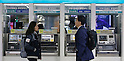 Benchmark rate, Mar 12, 2015 : People walk past automated teller machine of a bank in Seoul, South Korea. The Bank of Korea brought down the base rate to a record low of 1.75 percent on Thursday, according to local media.  (Photo by Lee Jae-Won/AFLO) (SOUTH KOREA)