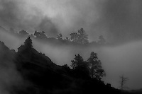 A passing storm deposits fog into Zion Canyon at Zion National Park, Utah