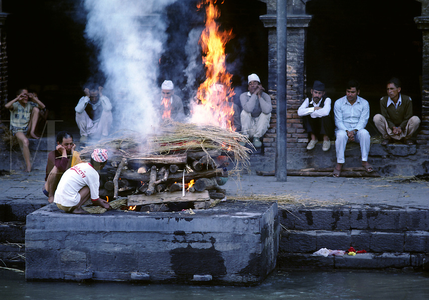 A human body is CREMATED along the BAGMATI RIVER at the Hindu Temple compex of PASHUPATINATH - KATHAMNDU, NEPAL