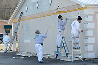 NWA Democrat-Gazette/ANDY SHUPE<br /> Jose Arujo (from right), Marino Lopez, Ignacio Alvares and Daniel Estrada, all of Ignacio's Painting in Lowell, work together Wednesday, Jan. 10, 2018, to paint the exterior of the former AQ Chicken Outback building on College Avenue in Fayetteville. The business closed in 2016, but will soon be home to Terps, a glassware and tobacco shop, with plans to franchise the business.