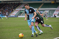 Matthew Bloomfield of Wycombe Wanderers goes past Carl McHugh of Plymouth Argyle during the Sky Bet League 2 match between Plymouth Argyle and Wycombe Wanderers at Home Park, Plymouth, England on 30 January 2016. Photo by Mark  Hawkins / PRiME Media Images.