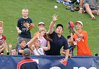 Young fans of the Greenville Drive jostle for a ball tossed into the stands during a game against the Lexington Legends on June 5, 2011, at Fluor Field at the West End in Greenville, S.C. Photo by Tom Priddy / Four Seam Images