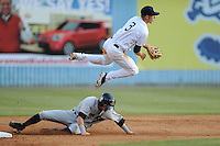Asheville Tourists shortstop Trevor Story #3 leaps over a hard charging Ben Gamel to complete a double play during a game against the Charleston RiverDogs at McCormick Field on May 28, 2012 in Asheville, North Carolina . The Tourists defeated the RiverDogs 15-12. (Tony Farlow/Four Seam Images).