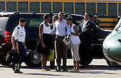 United States President Barack Obama, flanked by his wife Michelle and daughter Malia, get ready to board Marine One helicopter on Martha's Vineyard, Massachusetts Sunday, August 29, 2010. Daughter Sasha was nearby. The First Family completed their 10-day vacation on Martha's Vineyard and were flying to Cape Cod to board Air Force One  for New Orleans where the President is giving a speech today on the fifth year anniversary of Hurricane Katrina..Credit: Vincent DeWitt - Pool via CNP