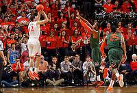Virginia guard Joe Harris (12) shoots over Miami defenders during an NCAA basketball game Saturday Feb, 24, 2014 in Charlottesville, VA. Virginia defeated Miami 65-40.