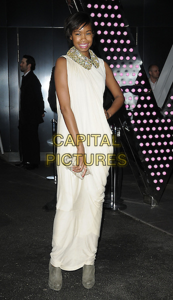 TOLULA ADEYEMI.Marie Claire Inspire And Mentor Campaign Cocktail Reception held at the W Hotel, Leicester Square - Arrivals..London, England, UK, 17th May 2011..full length white dress sleeveless long maxi hand on hip grey gray ankle boots gold sparkly collar clutch bag silver .CAP/CAN.©Can Nguyen/Capital Pictures.