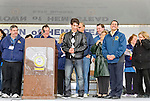 APRIL 16, 2011 - MERRICK, NY: Wiping a tear from her eye, Lauren Rosen (at far right), the mother of Robbie Rosen American Idol contestant, proudly watches her son receive citation from President of Merrick Chamber of Commerce, Randy Shotland, in honor of Robbie Rosen Day at Merrick Kid Fest. Robbie's grandmother is holding boquet of flowers next to his mother. Local politicians and Chamber of Commerce members also on stage, at Merrick, Long Island, New York, USA. (EDITORIAL USE ONLY)