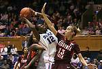 15 February 2012: Duke's Chelsea Gray (12) is defended by Virginia Tech's Alyssa Fenyn (13). The Duke University Blue Devils defeated the Virginia Tech Hokies 67-45 at Cameron Indoor Stadium in Durham, North Carolina in an NCAA Division I Women's basketball game.