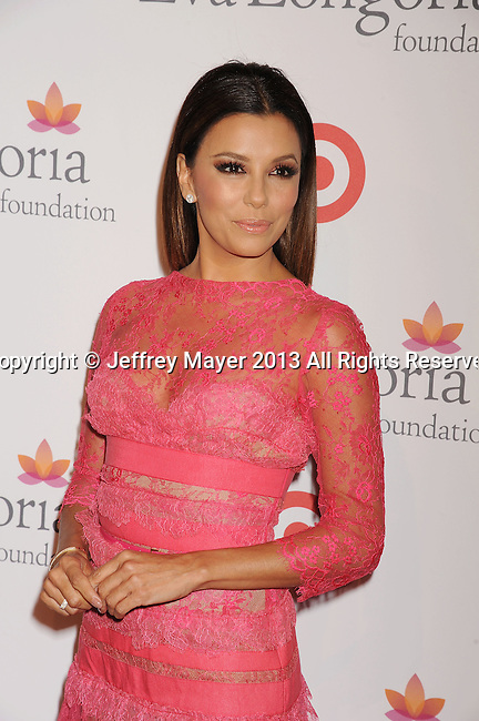 HOLLYWOOD, CA- SEPTEMBER 28: Actress Eva Longoria arrives at the Eva Longoria Foundation Dinner at Beso restaurant on September 28, 2013 in Hollywood, California.