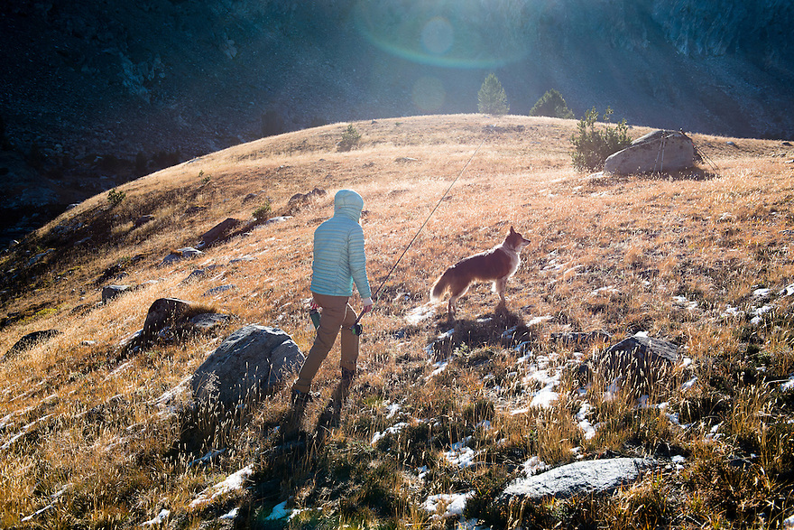 Christine Marozick, of Bozeman, Montana, hikes with her dog, Kato, after fly fishing the Tobacco Root Mountains near Twin Bridges, Montana.